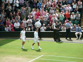 Roger and Andy walk onto court